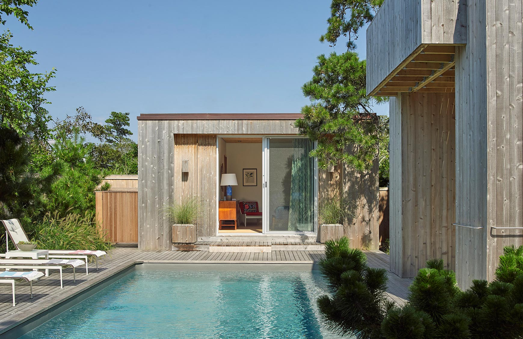 Modernist beach house and pool house addition