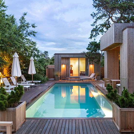 A restoration of and addition to a landmark modernist Fire Island house includes a new guest house, pool, exterior stair, entry pavilion, and landscaping.