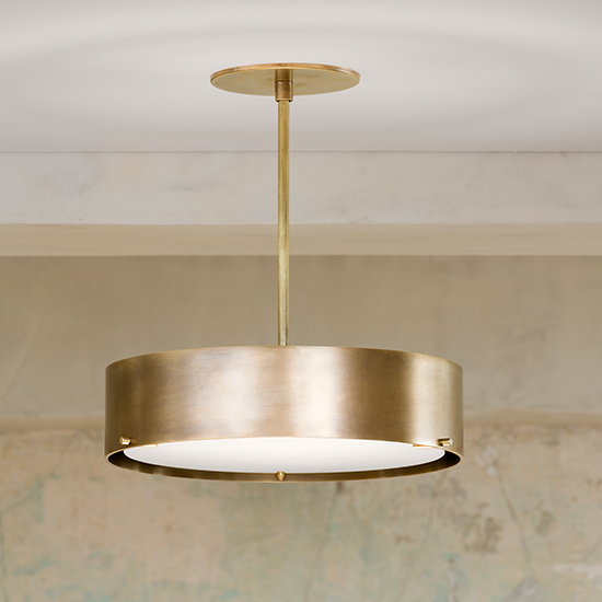 The Alberto Pendant is a cylindrical shade made from solid hand-rubbed brass and glass. Its minimal, elegant design provide for a solid yet quiet presence in any space.