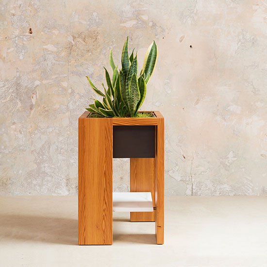 Part of the Box Table Series, The Leon Plant Stand is a hand-crafted, adaptable wood frame table that features a bronze box insert to be used as a planter.