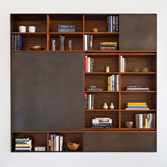 This timeless, adaptable, and thoughtfully crafted modular wall unit offers discrete storage behind wood or metal-clad sliding panels alongside open shelves.