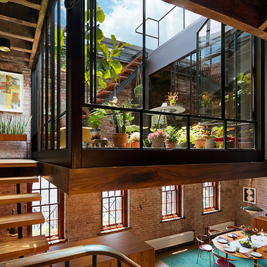 The top floor and roof of an 1884 caviar warehouse are reconceived as a warm and open residence with an interior court connecting to a new green roof garden.