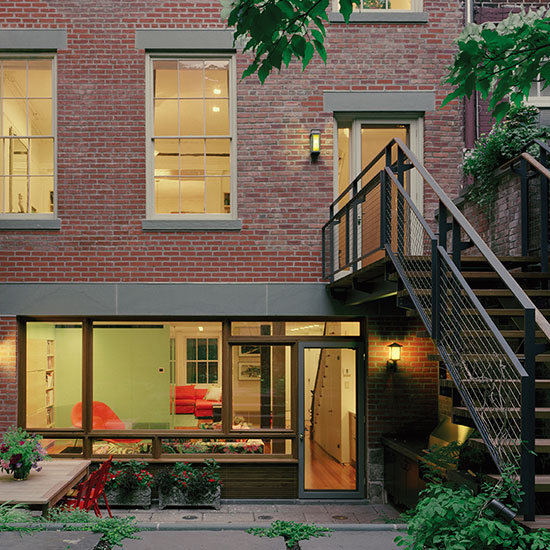This Greenwich Village landmark district historic townhouse renovation and enlargement includes a finished garden, outdoor room and an improved penthouse level.